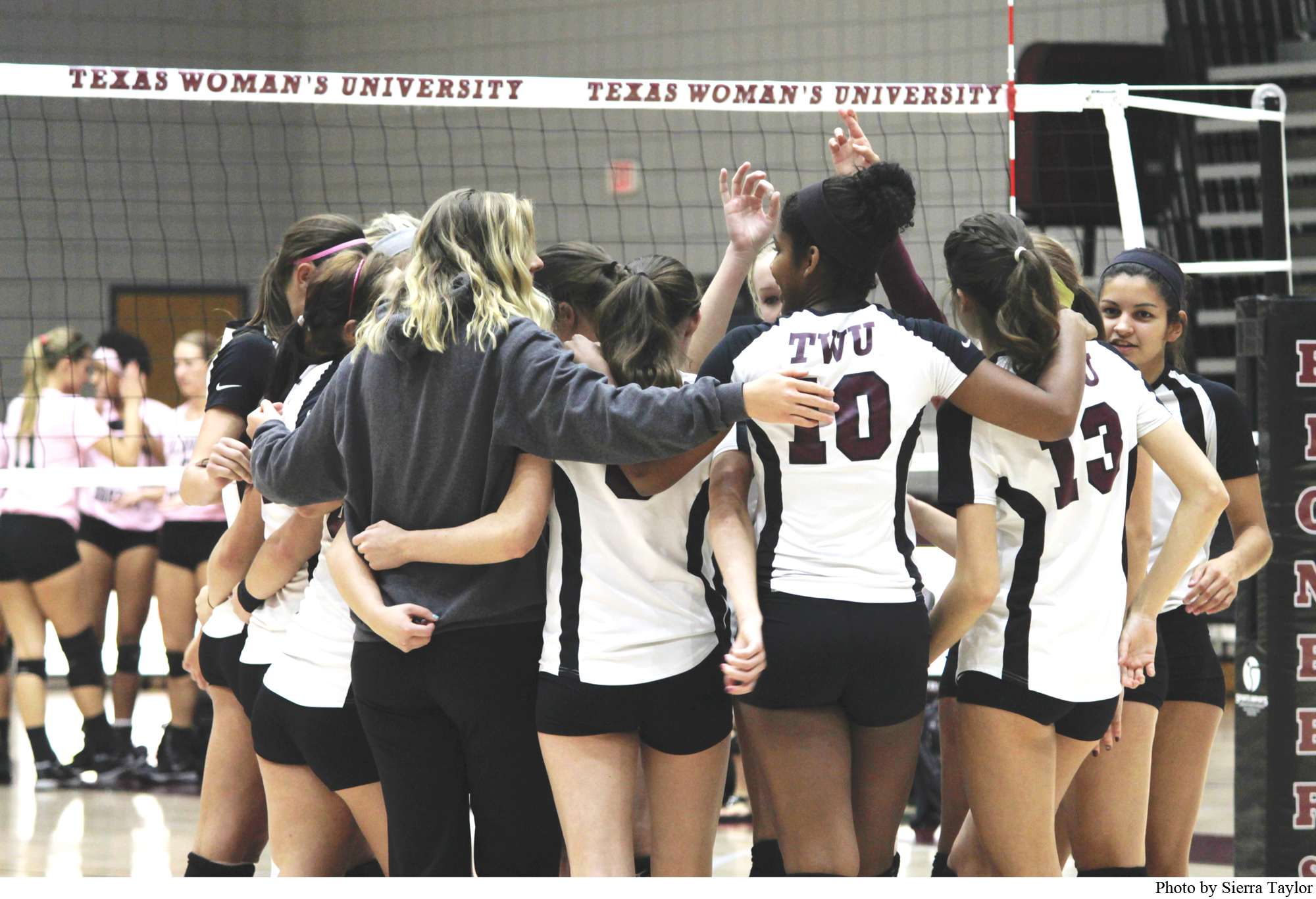 TWU Lady Pioneers huddle with their coach prior to the game on Oct. 13, 2015.