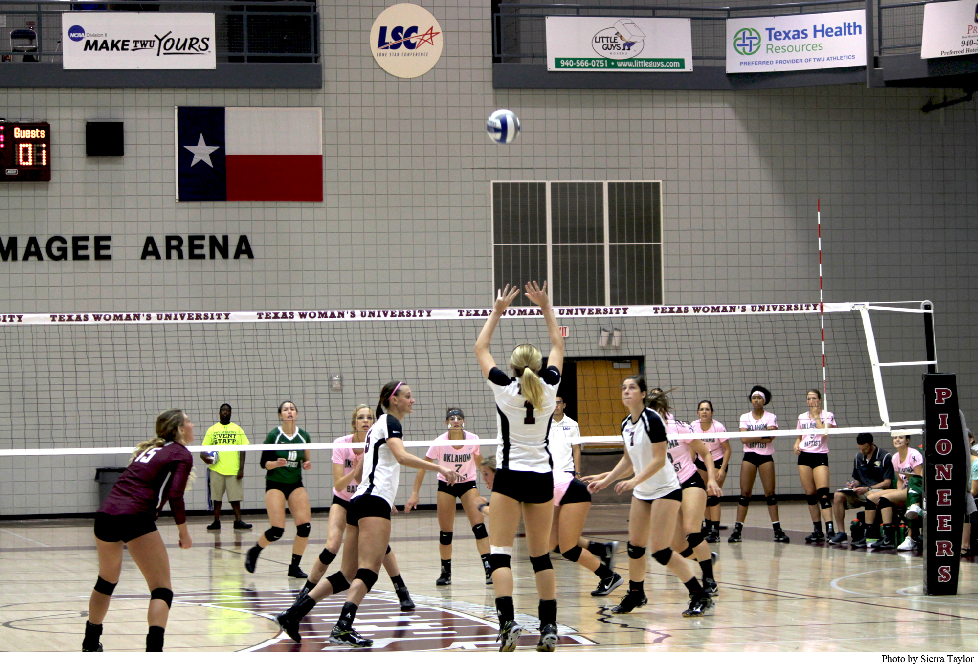 Outside Hitter Mallory Kuechle #1 makes an effort to spike the ball in the game against the Oklahoma Baptist Bisons.