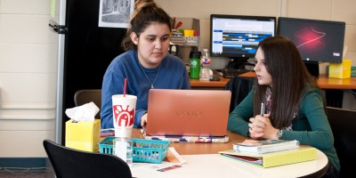 Junior English major Madeline Van Zant helps Junior Government major Magali Martinez with questions regarding a paper in the Write Site during a tutorial appointment. The Write Site is available for all students, six days a week, for assistance with writing assignments in all subjects.