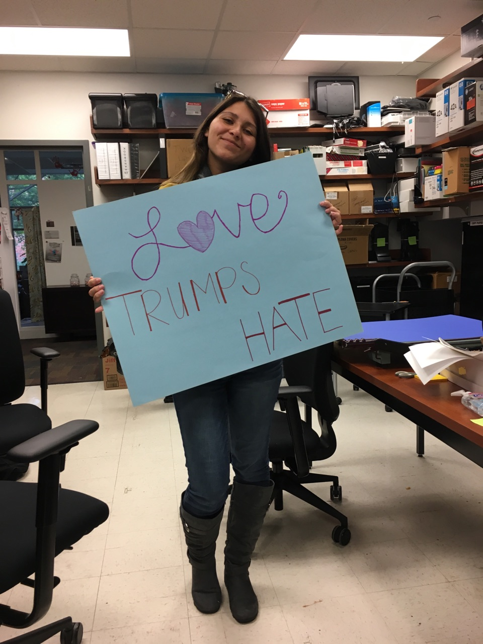 "Jessica Dominguez holding ""Love Trumps Hate"" poster"